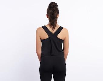 Cross back jumpsuit for women. Black lightweight ponte. Sleeveless. Round neckline. Long legs. Elastic waist. Side pockets.