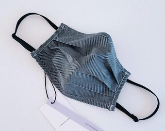Homemade mask striped cotton unisex small size with adjustable elastics and filter pocket. Lined in cotton voile. Metal rod at the nose