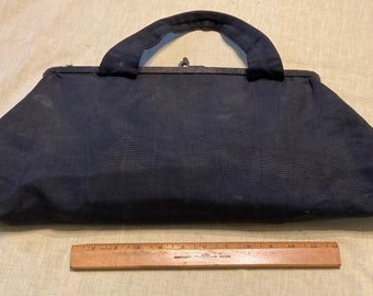 Vintage knitting bag filled with knitting needles, crochet hooks, etc.