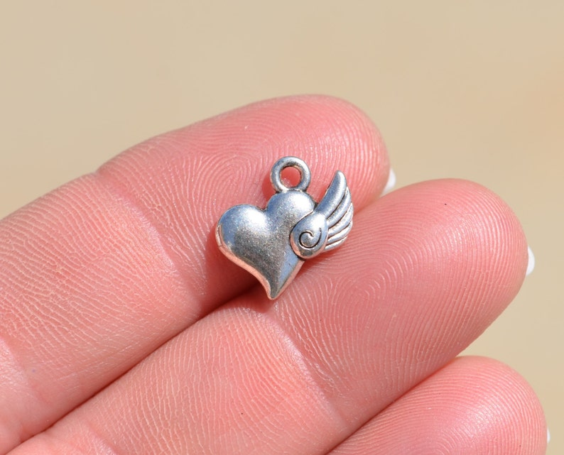 10   Hearts with a Wing Silver Tone Charms SC3559