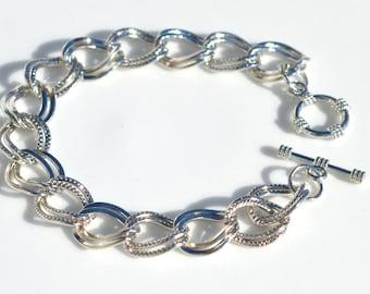 10  Charm Silver Tone Bracelets C809
