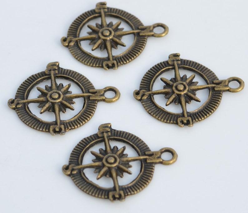 1 Compass Bronze Tone Charm BC6129