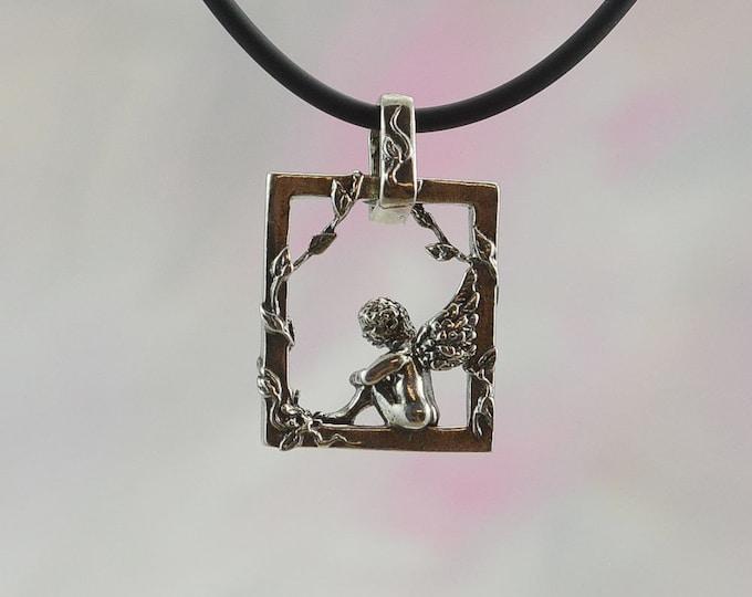 Enchanting Cherub and Vine Pendant in Sterling Silver