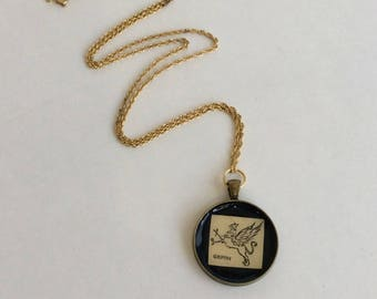 Vintage Dictionary Pendant Featuring a Griffin