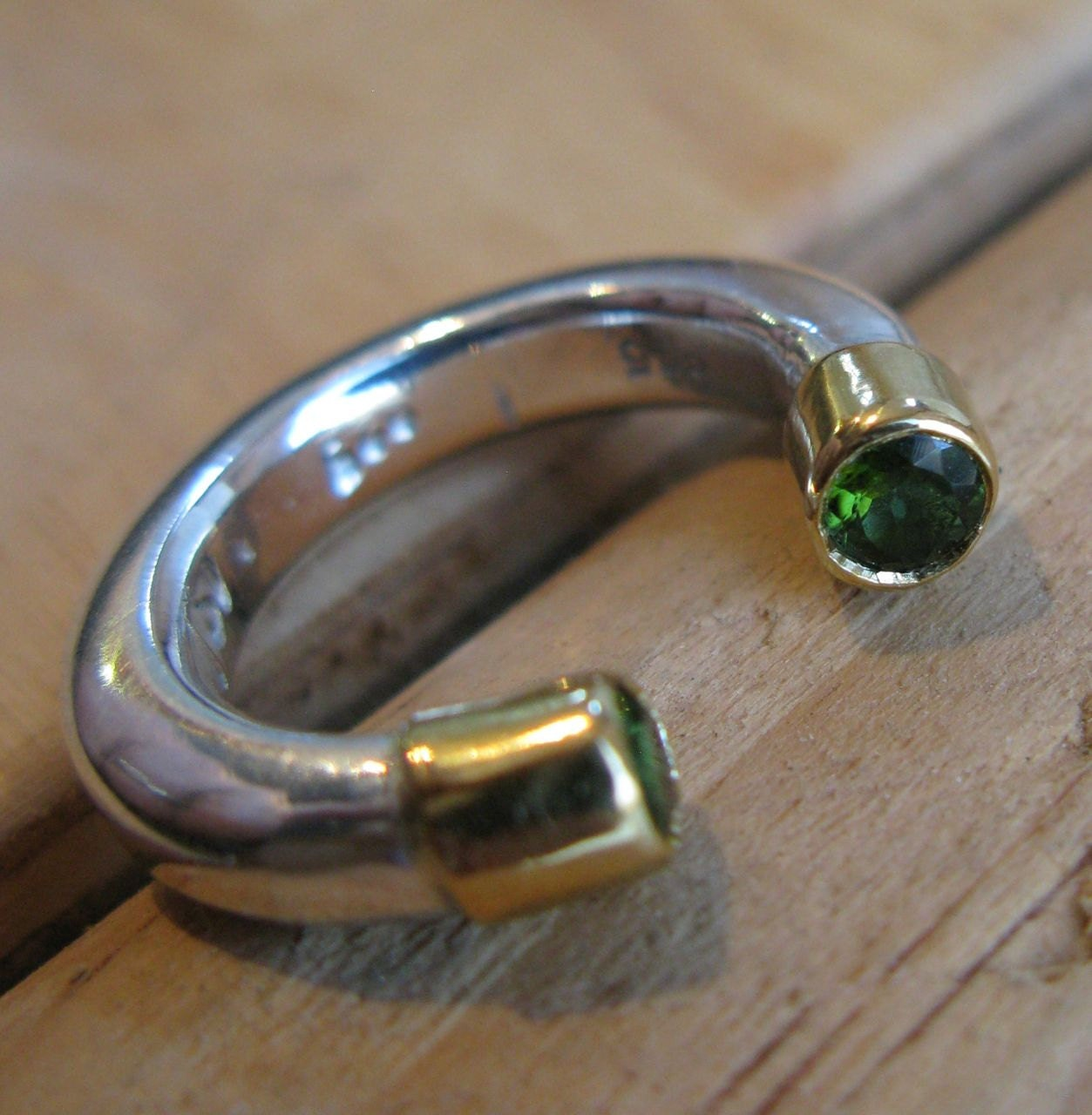 Horse Shoe Ring in Sterling Silver with Gold Peridot Caps (Bezels) and Green Peridot Gold d2db1b