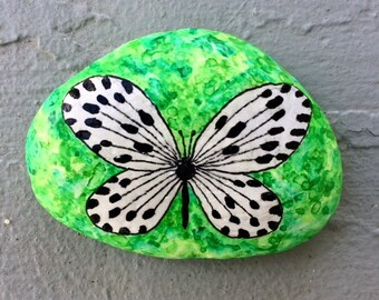 Black and white butterfly painted rock
