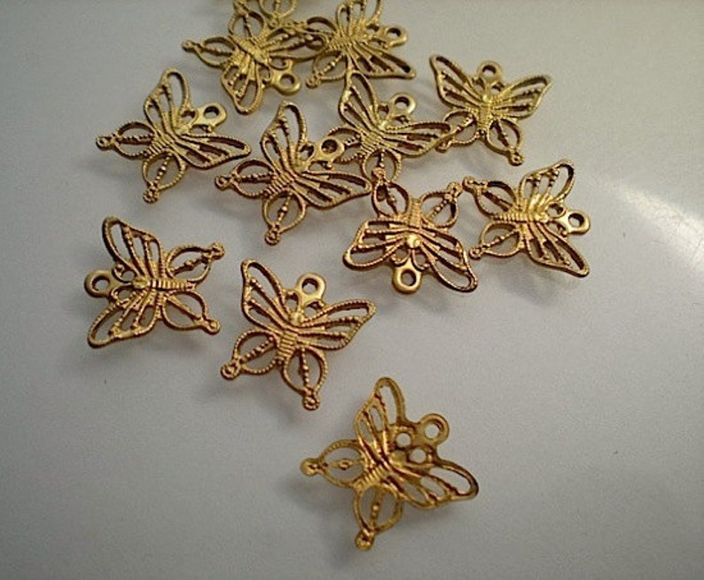 12 tiny filigree butterfly charms