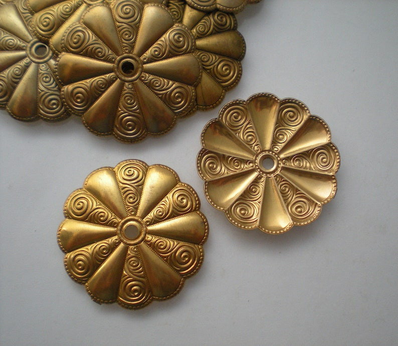 No 15-Large 12 brass mirror rosettes
