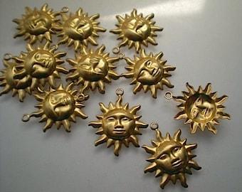 12 brass sun charms