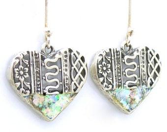 Heart shaped earrings with roman glass filigree design