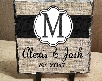 """Personalized Burlap,names and established date ,plaque black lettering, heat set on an 8""""x8"""" slate with feet"""