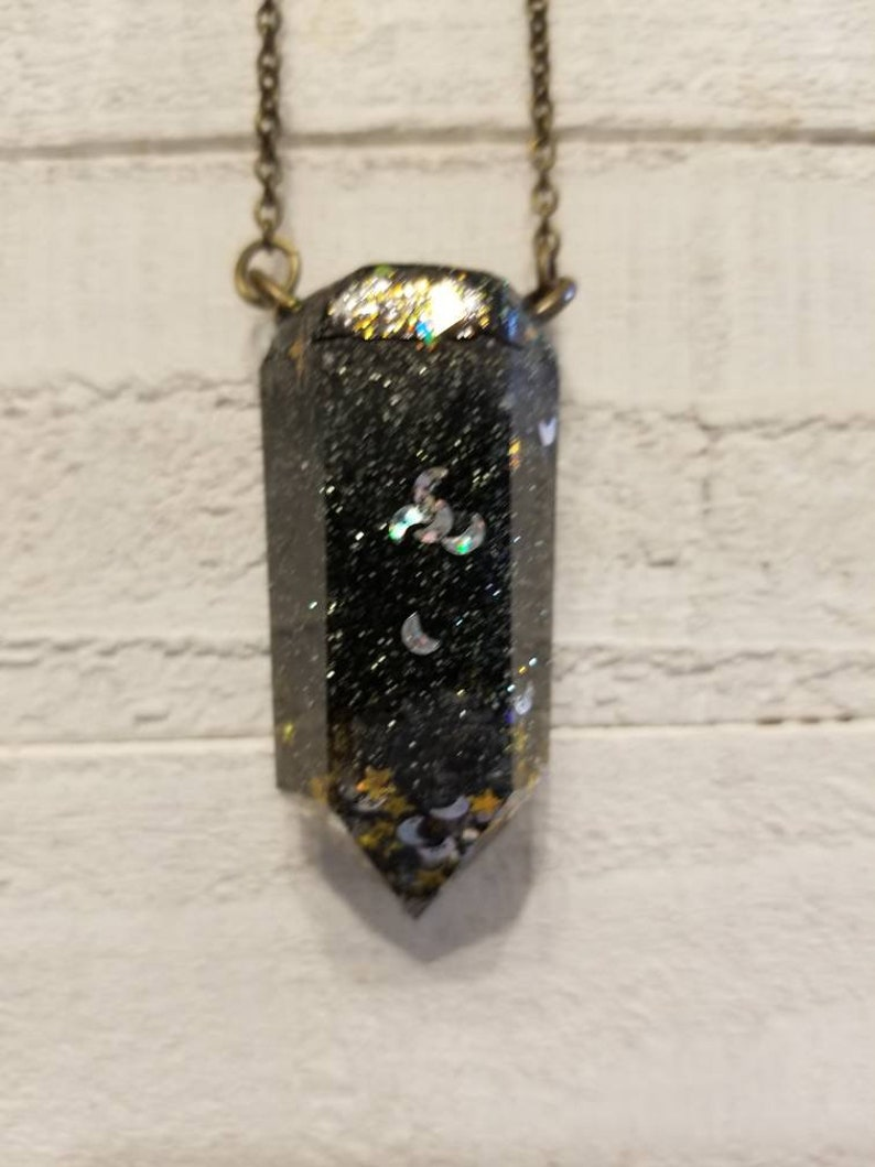 Moon and glittering Stars. Silver The Facetedheart Crystal Resin Point Amulet necklace infused with glistening Black