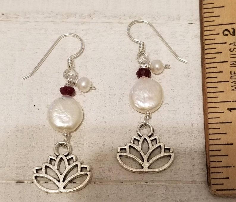 Blooming lotus flower drop earrings with garnets and fresh water pearls.