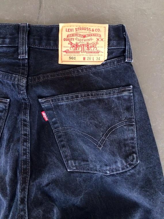 The Vintage Black Levi's 501 Raw Hem Jeans