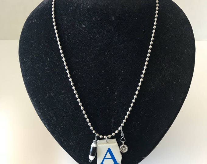 Upcycled Alabama license plate necklace with charms.
