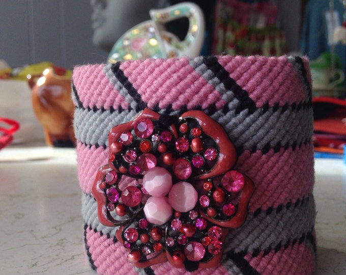 Hand woven cuff, pink, black, grey and cotton yarn. Large pink rhinestone flower.
