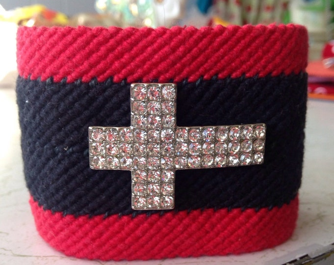 Like a prayer cuff bracelet. Hand woven, cotton yarn, rhineston cross.