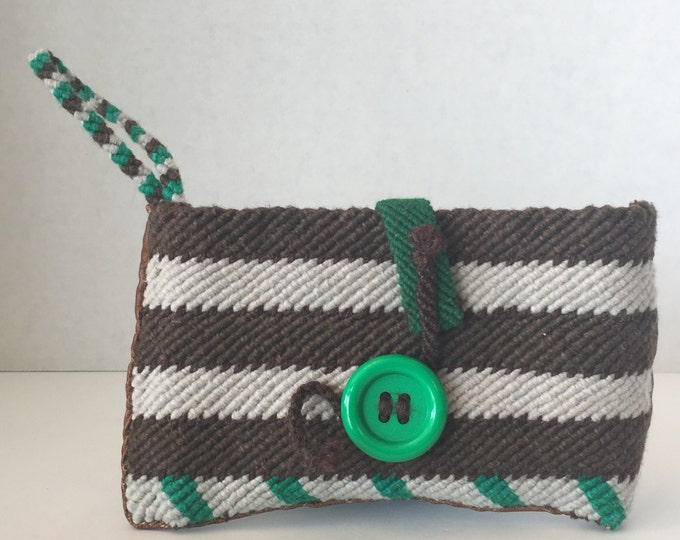 Handmade woven wristlet with cotton yarn and upcycled leather.