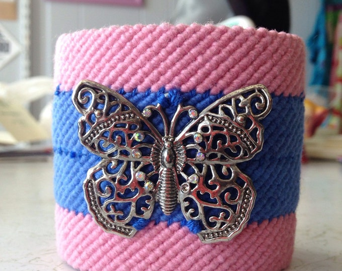 Hand woven cuff bracelet, pink and blue cotton yarn. Butterfly charm.