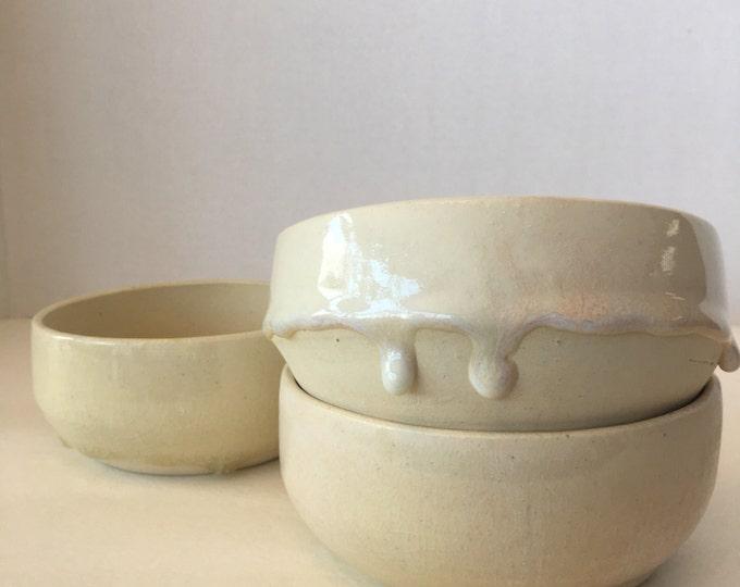 Four hand thrown bowls