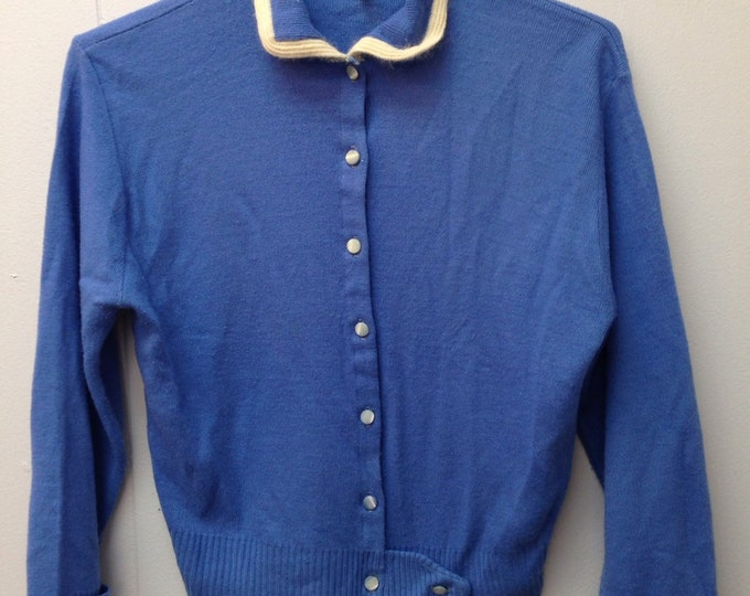 1950s dark blue Penney's Sweater with glass buttons.