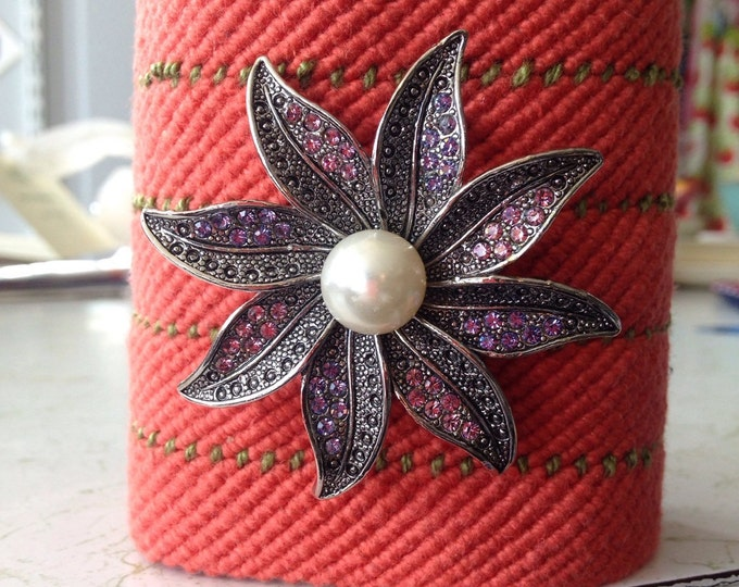 Hand woven cuff bracelet. Cotton yarn, melon and green with jeweled flower pin.