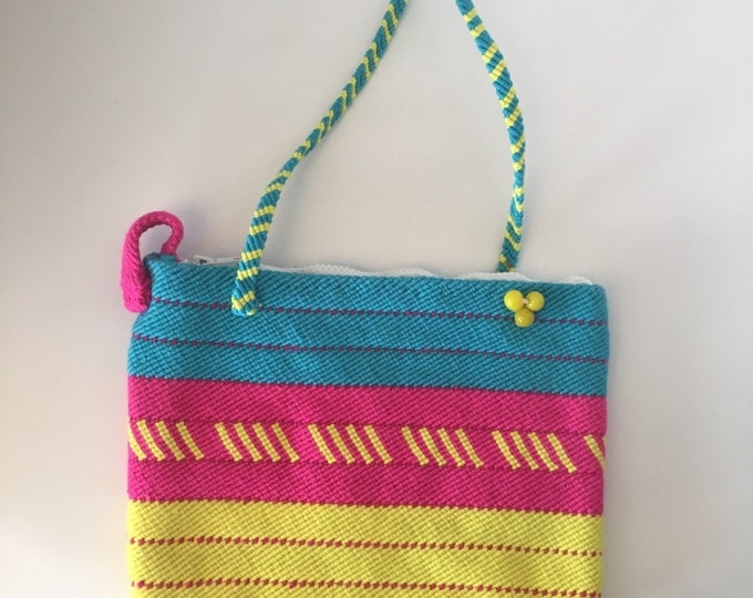 Molly Ringwald the Purse. Handmade, woven purse with zipper and strap.