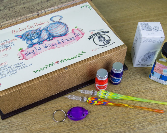 Featured listing image: Cheshire Cat Madness Glowy Ink Writing & Drawing Set - Noodler's Blue Ghost Ink