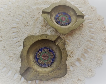 Two Chinese Brass Ashtrays with enamel and symbolic design