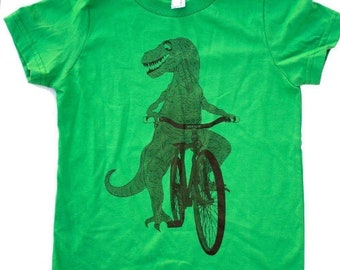 129540fe Dinosaur on a Bicycle- Kids T Shirt, Children Tee, Cotton Tee, Handmade  graphic tee, sizes 2-12. darkcycleclothing
