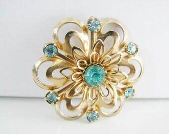 Vintage gold flower brooch with aqua blue rhinestones (G3)