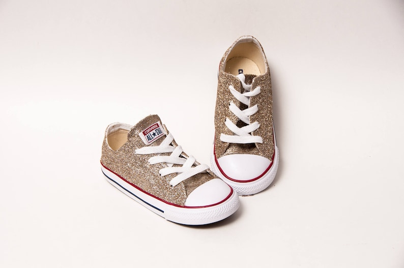 7c2a7db94c3f Toddler Glitter Champagne Converse® Low Tops
