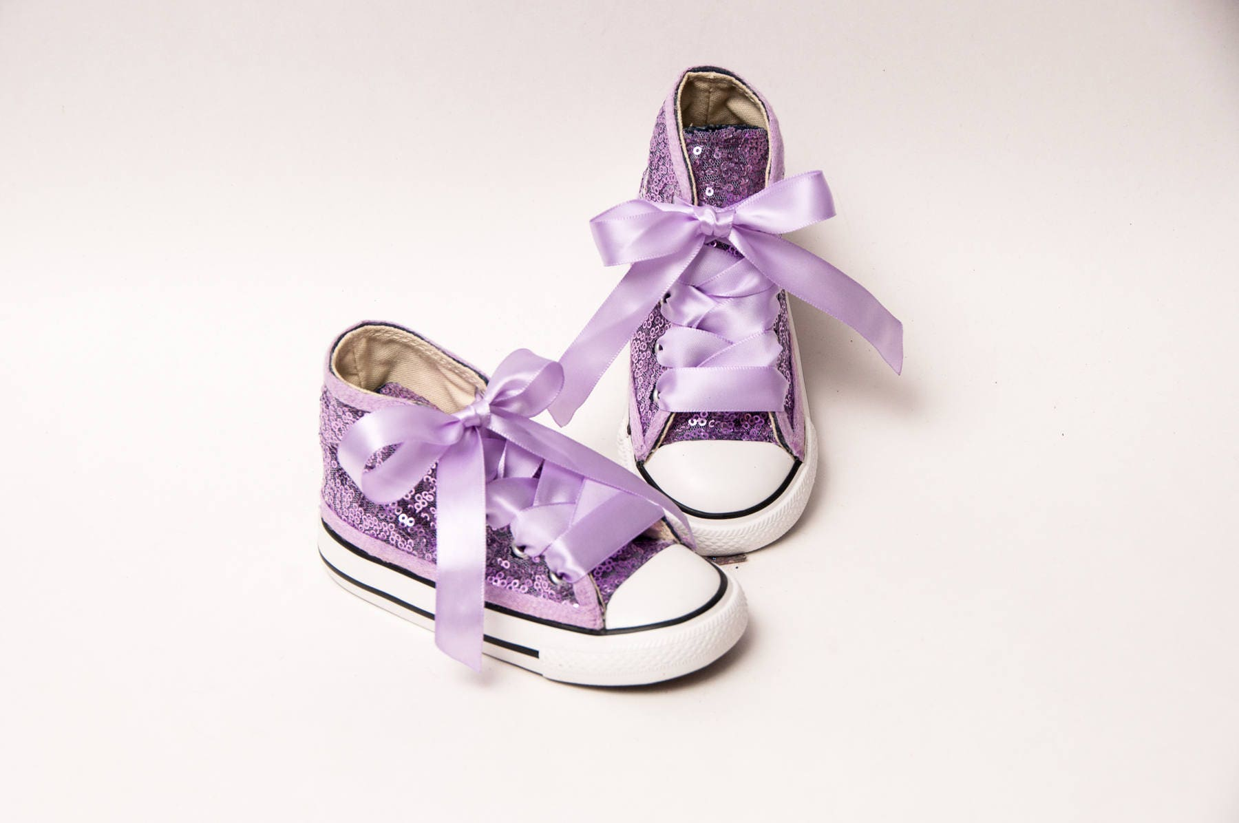 7297e37021a7b Toddler Lavender Sequin Converse® High Tops