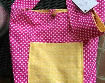 pink, yellow, and polka dots reversible handbag
