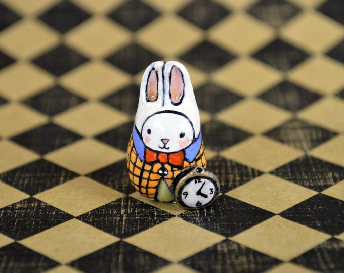 Bibbit Plays The White Rabbit. We love Alice in Wonderland