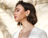 Noel - floral burst brass earring with crystal