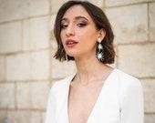 Elia Earrings in mother of pearl, starburst drop