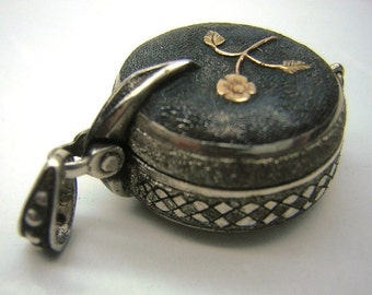 small hanging box, silver and gold