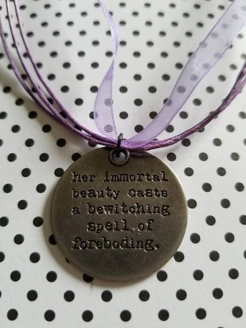 Her immortal beauty casts a bewitching spell of foreboding - quote - quote  necklace - quote pendant - poetry - stamped jewelry - gift