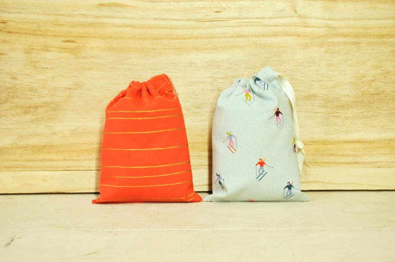 Drawstring Pouch  Reusable Gift Bag  Holiday Skiers and Gold image 0