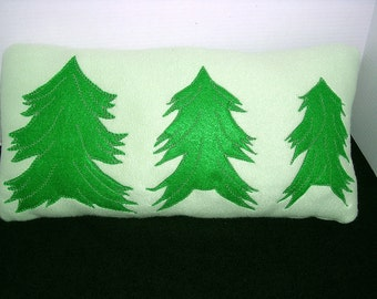 Fleece pillow in soft green with bright green and silver appliquéd trees
