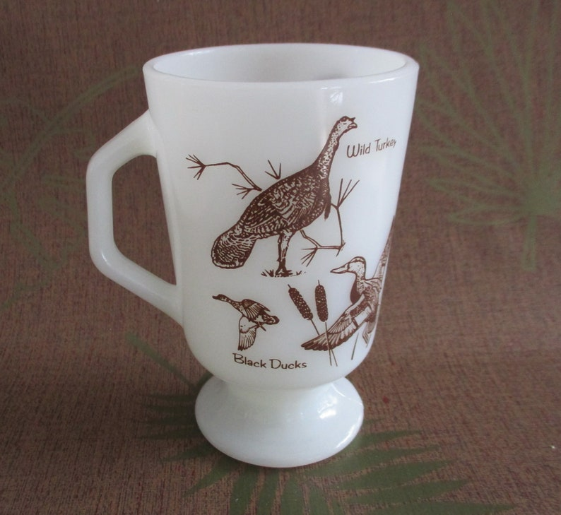 Fire King Wild Birds Milk Glass Footed Mug 5 in. high x 3 in. image 0