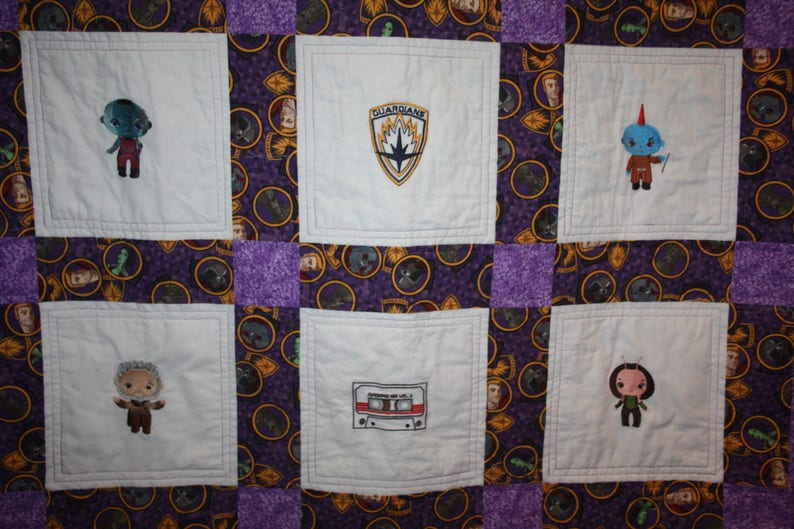A Galaxy filled with Guardians Lap Quilt