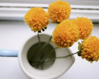As sold online at Anthropologie May 2013 - Pomdelions set of 5.  Home decor, dorm room, centerpiece, table decor, wedding.