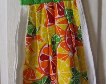 1 Orange, Lime slices cotton kitchen towel with bright green cotton potholder on top