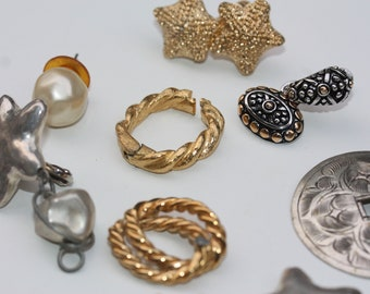 All the single earrings... All the single earrings... put your arms up!  Oh my, what can you do with these - incorporate them into your art!