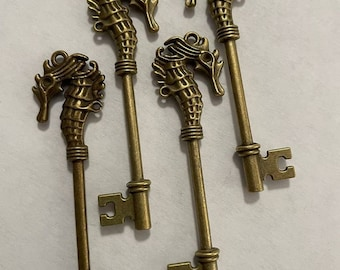 4 Horse Charms in bronze color