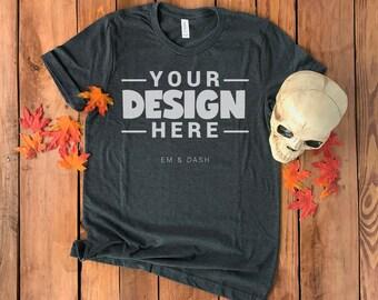 Bella Canvas 3001 Dark Gray Heather T-Shirt, Halloween Fall Flat Lay | Skull + Leaves on Rustic Wood Background