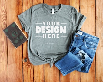 Bella Canvas 3001 Deep Heather T-shirt Flatlay Styled Mockup with Jeans and Book