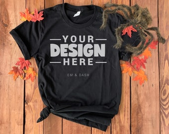 Bella Canvas 3001 Black T-Shirt, Halloween Fall Flat Lay | Leaves and Scarey Spider on Rustic Wood Background